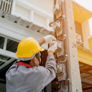 Man Performing Electrical Contracting Services
