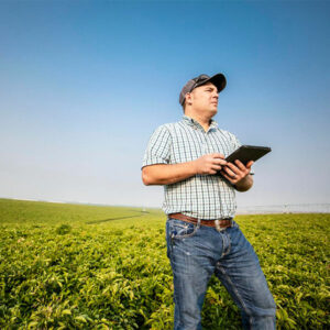 Man Standing in Field using Irrigation Control Technology