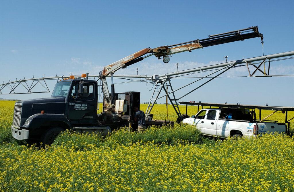 Western Water Management Service Truck Performing Irrigation Maintenance in a Field in Saskatchewan, Canada