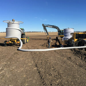 Two People performing Tile Drainage Services in Saskatchewan, Canada